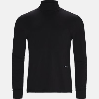 Regular fit | Long-sleeved T-shirts | Black