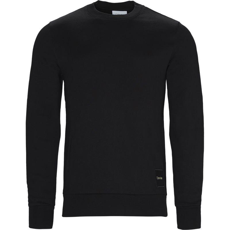 Calvin klein regular fit k10k102721 sweatshirts sort fra calvin klein fra axel.dk