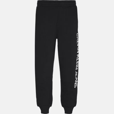 Regular fit | Trousers | Black