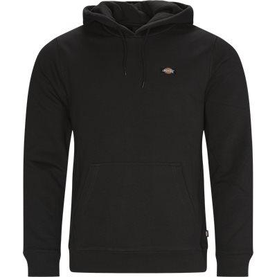 Regular fit | Sweatshirts | Svart